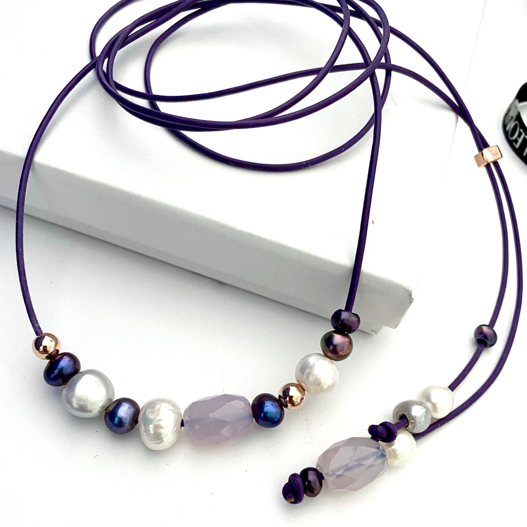 Leoni & Vonk purple leather necklace photographed on a white box