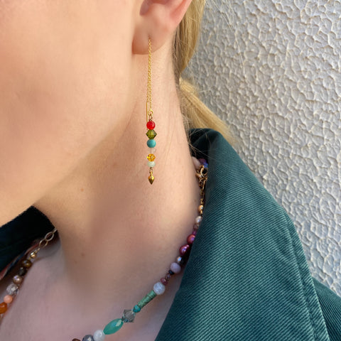 Model wearing Leoni & Vonk colourful semi precious stone jewellery and a green jacket