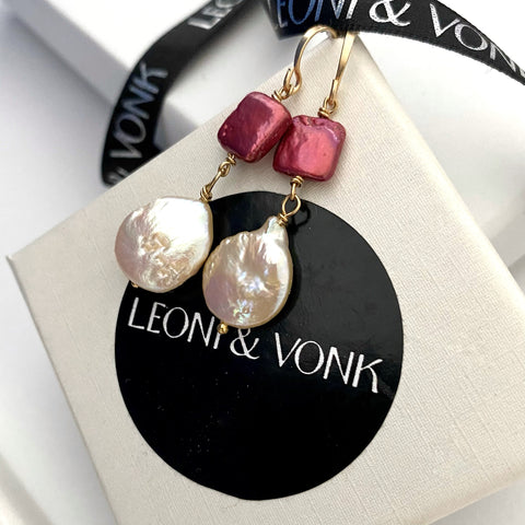 Leoni & Vonk rose pearl and gold earrings photographed on a Leoni & Vonk box and ribbon