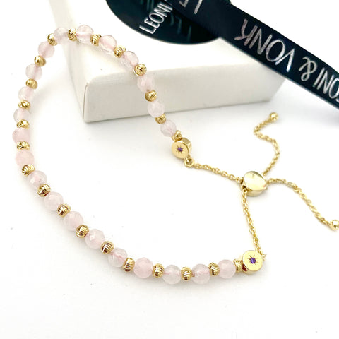 Leoni & Vonk rose quartz gold friendship bracelet photogprahed near Leoni & Vonk ribbon