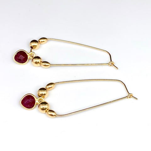 Leoni & Vonk gold fill and ruby heart hoop earrings on a white background