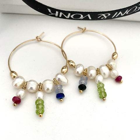 Leoni & Vonk sapphire, ruby and peridot and pearl hoop earrings photographed near Leoni & Vonk ribbon