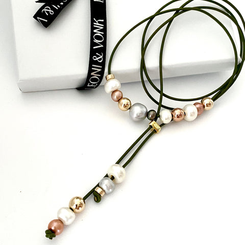 Leoni & Vonk sage green leather and pearl necklace  photographed near Leoni & Vonk ribbon