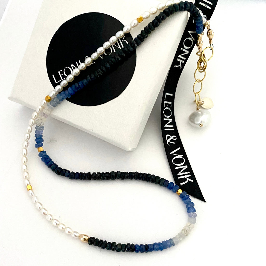 Leoni & Vonk pearl and sapphire necklace photographed on a Leoni & Vonk white box
