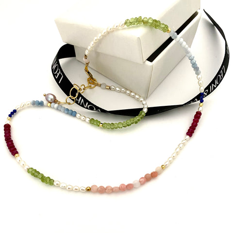 Leoni & Vonk semi-precious stone adn pearl necklace photogrpahed near Leoni & Vonk ribbon and a white box