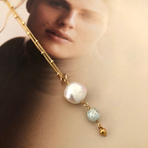 Leoni & Vonk keshi pearl and gold drop necklace against a magazine page