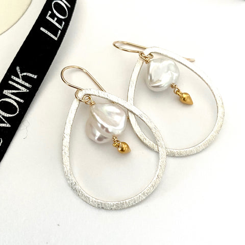 Leoni & Vonk silver teardrop and keshi pearl earrings photographed near Leoni & Vonk ribbon