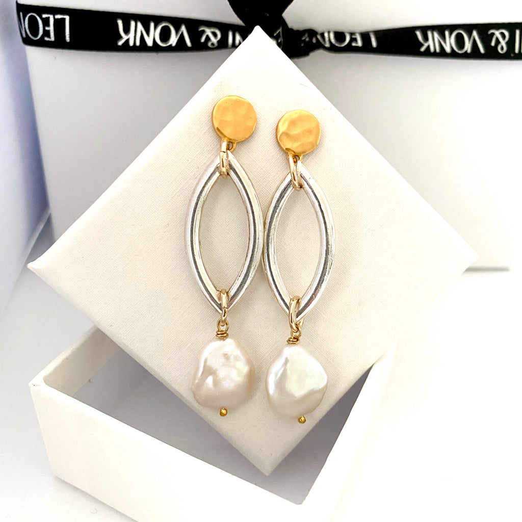 Leoni & Vonk sterling silver link, gold stud and pearl earrings photographed on a white box