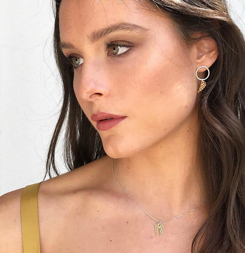 Model wearing Leoni & Vonk sterling silver gold wing necklace