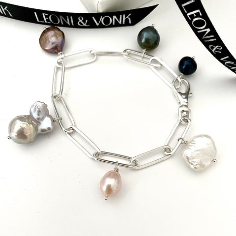 Leoni & Vonk luxe sterling silver pearl charm bracelet photographed near a Leoni & Vonk box and ribbon