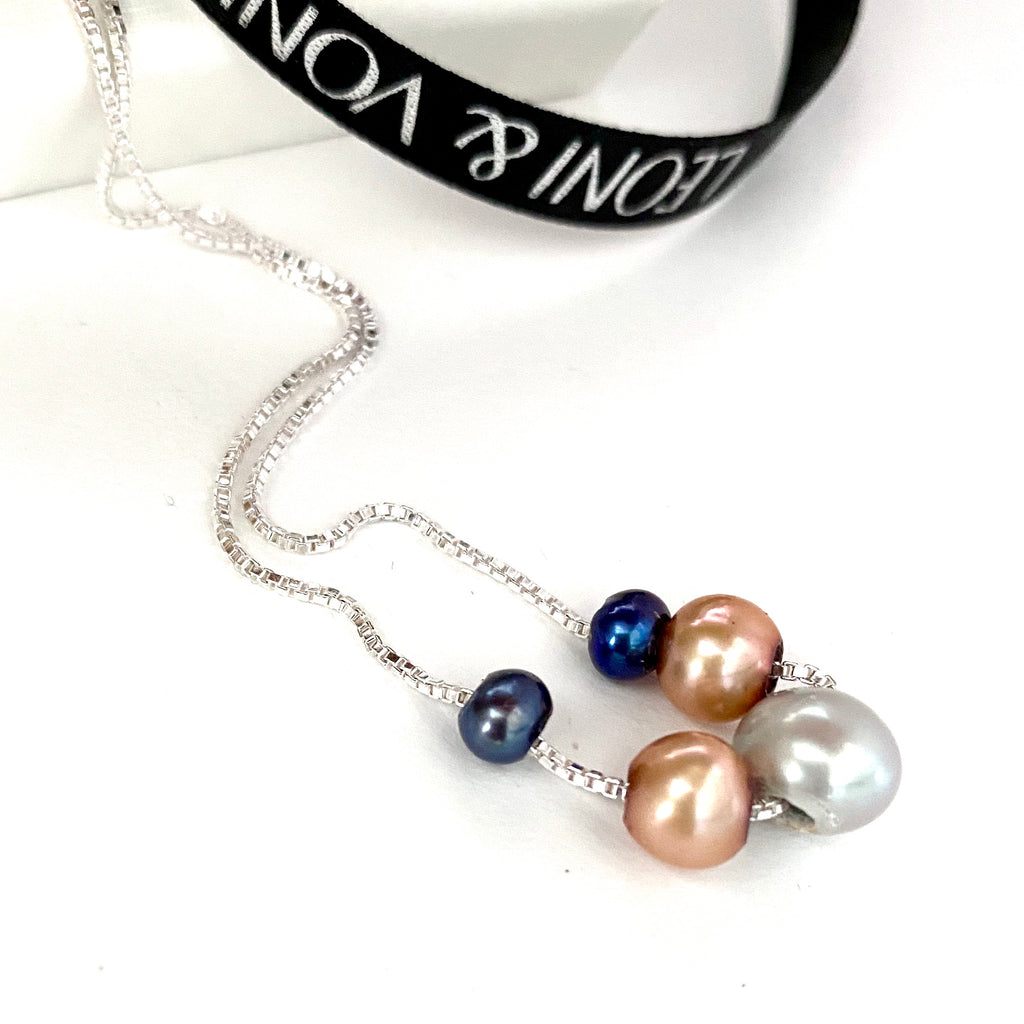 Leoni & Vonk sterling silver pearl necklace photographed near Leoni & Vonk ribbon