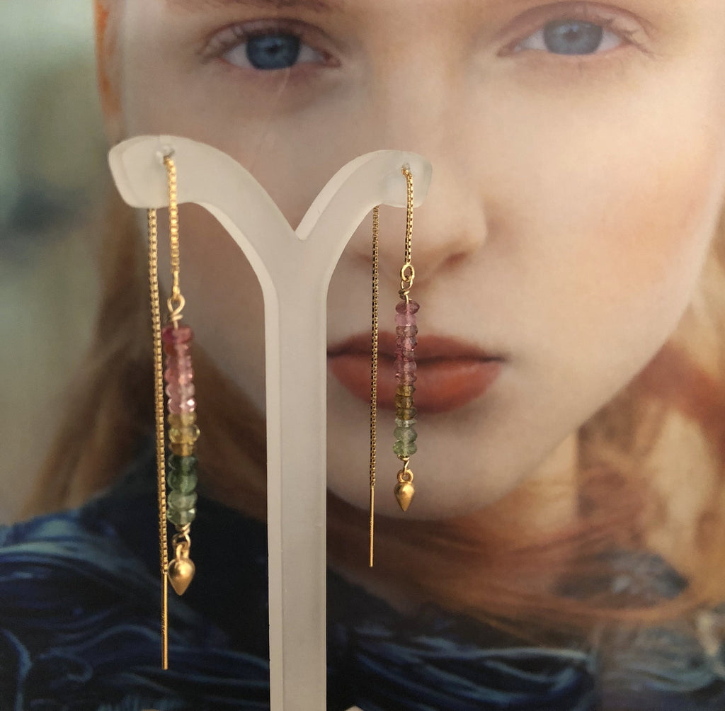Leoni & Vonk gold fill and tourmaline ear thread earrings photographed on a magazine page