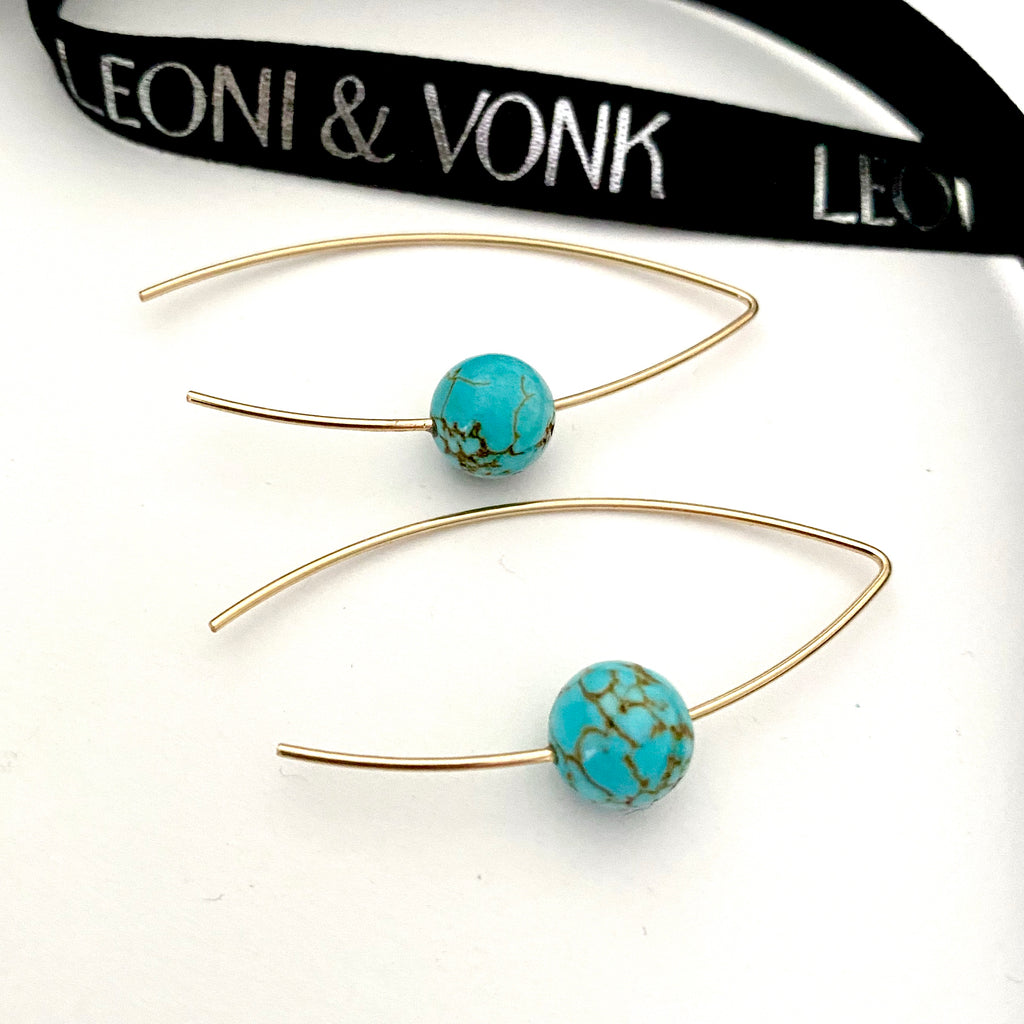 Leoni & Vonk turquoise howlite and gold fill earrings photographed near Leoni & Vonk ribbon