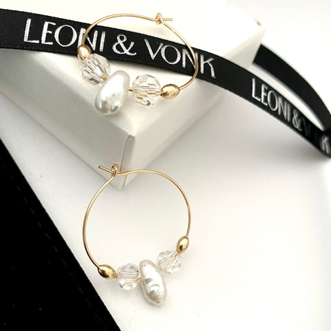 Leoni & Vonk vintage crystal and pearl gold hoop earrings photographed near Leoni & Vonk ribbon and a box