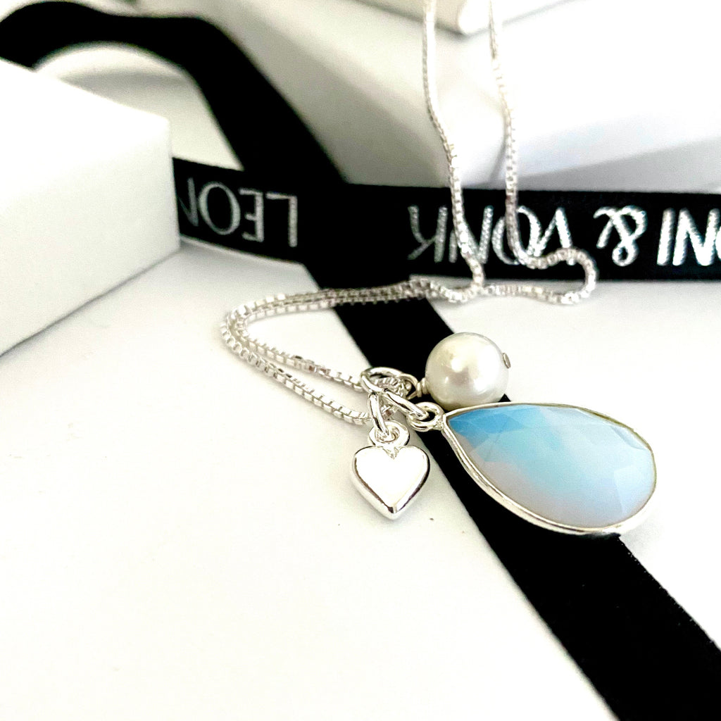 Leoni & Vonk opalite quartz, pearl and heart necklace photographed near Leoni & Vonk ribbon