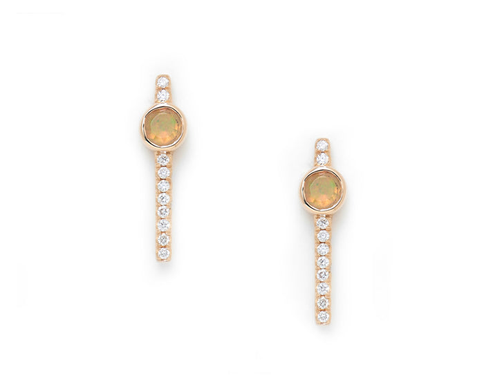 linear 14k yellow gold white diamond pavé studs with off center faceted opal settings.