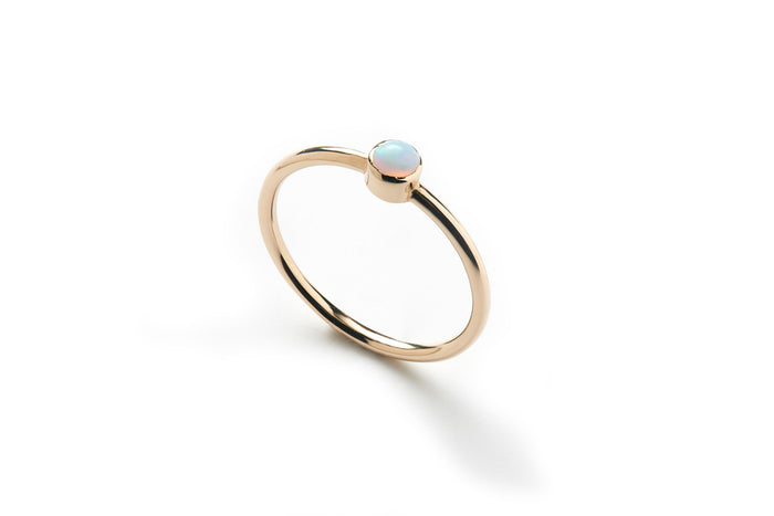 delicate 14k yellow gold ring with opal