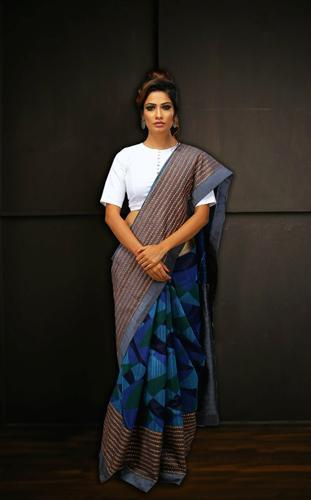 Handwoven Matka Silk Saree with Blue Geometrical Weaves and Hand Embroidery Lines
