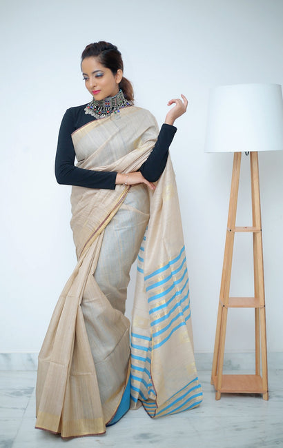 Beige Saree with Stripped Blue & Gold Pallu