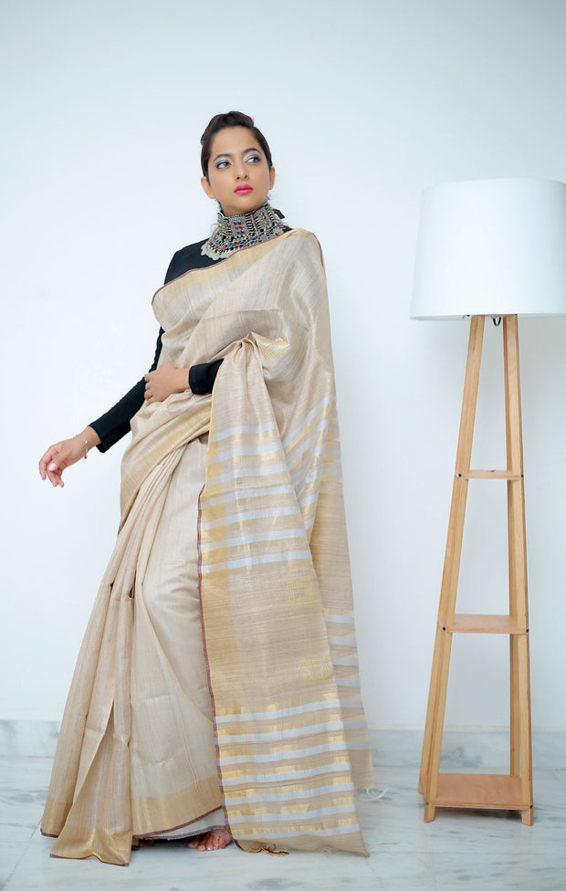 Beige Saree with Stripped Grey & Gold Pallu