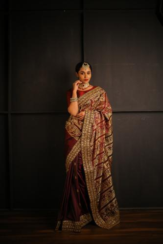 Wine and Gold Handwoven Baluchari Silk Saree with Hand Embroidered Work on Borders