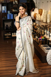 Off White Hand Embroidered Linen Saree with Zari Border