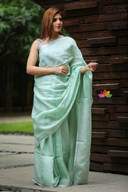 Paled Turquoise Handwoven Linen Saree with Zari Border