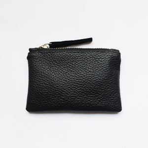 This classic black vegan leather coin clutch from Mezay Ugbo is available with either a gold or silver zip