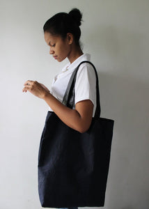 Every day tote in soft denim to hold laptop, books and essentials by Mezay Ugbo