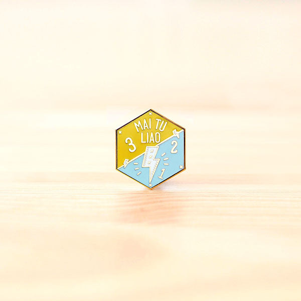 Strangely Singaporean Pin – Mai Tu Liao