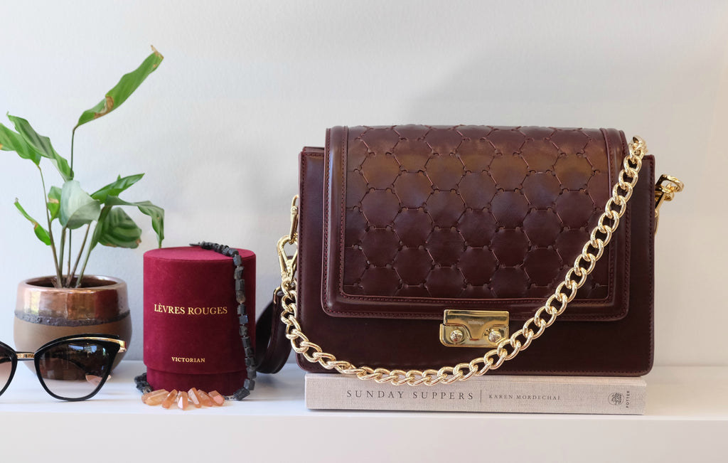 bordeaux luxury leather crossbody handbag with flap and golden chain handle