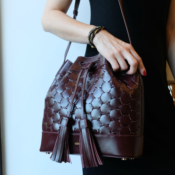 bordeaux woven leather luxury bucket bag sustainable drawstring