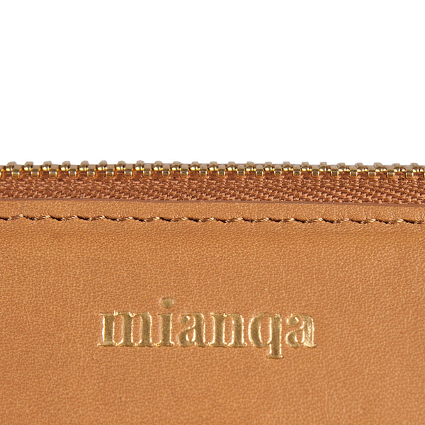 logo detail of leather clutch bag in tan color