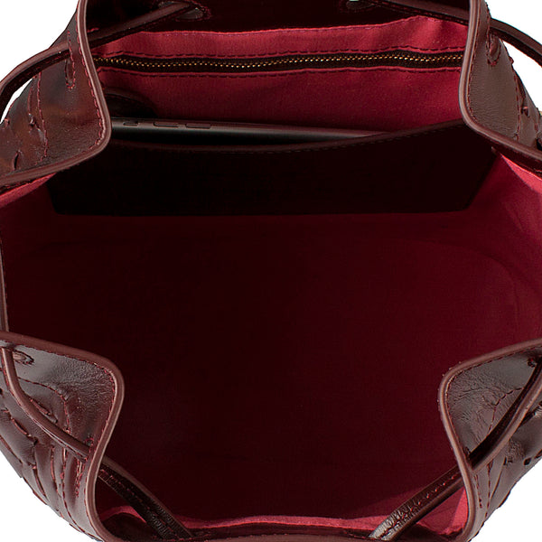 inside of luxury leather handwoven bucket bag bordeaux