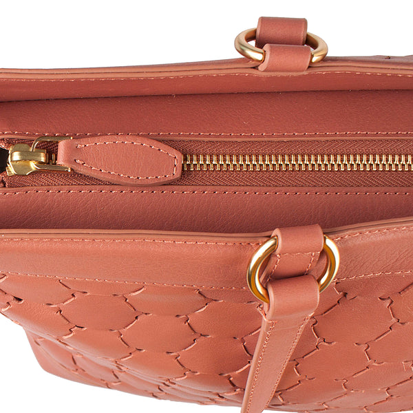 antique pink luxury leather tote bag with handwoven body zipper closure detail