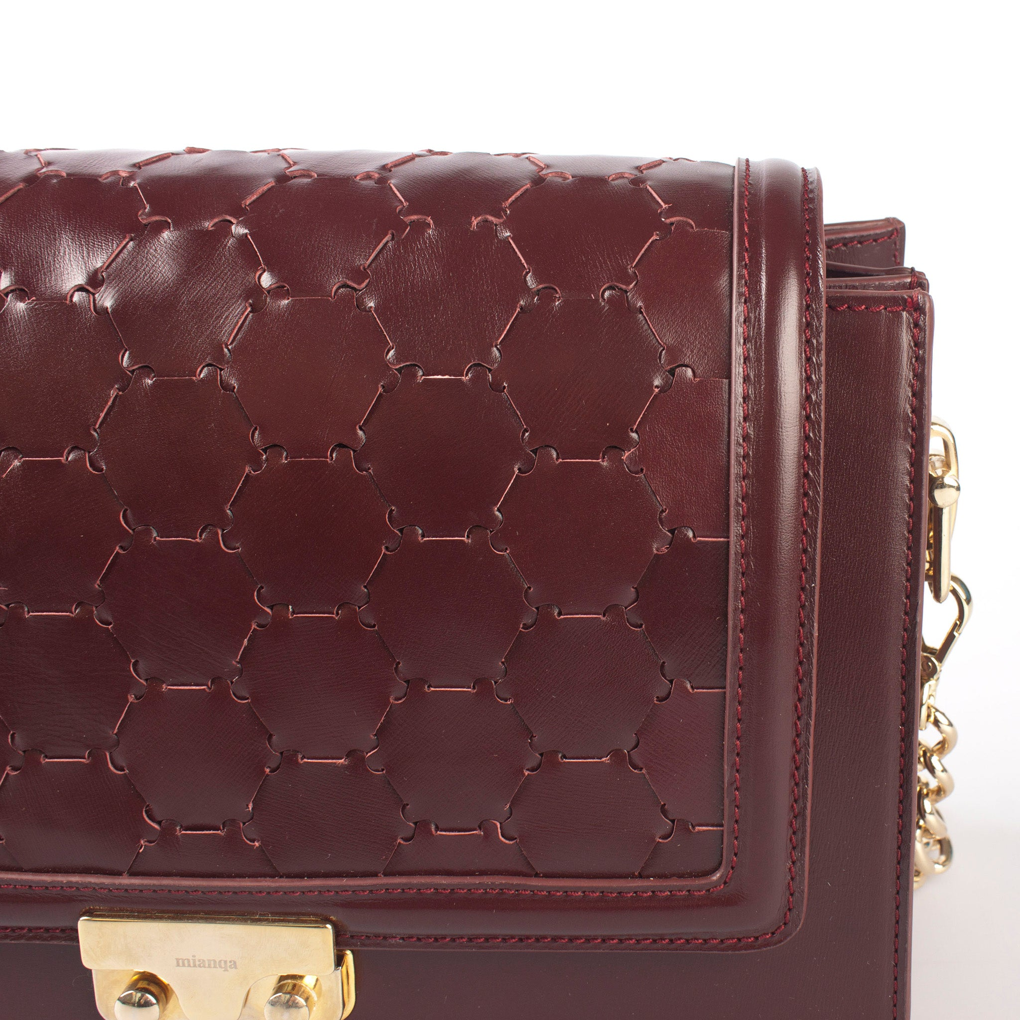 bordeaux luxury leather crossbody bag with handwoven flap and chain handle flap detail