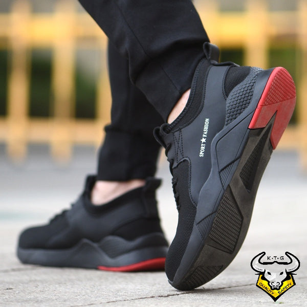 Model wearing KTG Safety Steel Toe Sports Safety Shoes Model SS47 - Knitted Mesh Black Red Sole - Kevlar anti smash display