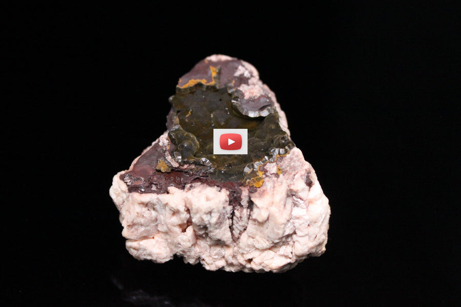 Hematite with a Goethite covering on Microcline and Goshenite Matrix