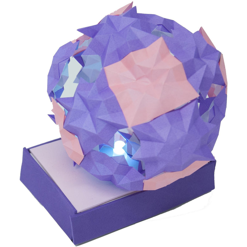Spherical origami ball made of purple and pink paper activated with Teknikio LED components
