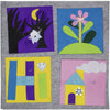 Four sample quilt squares with electronics components designed by students
