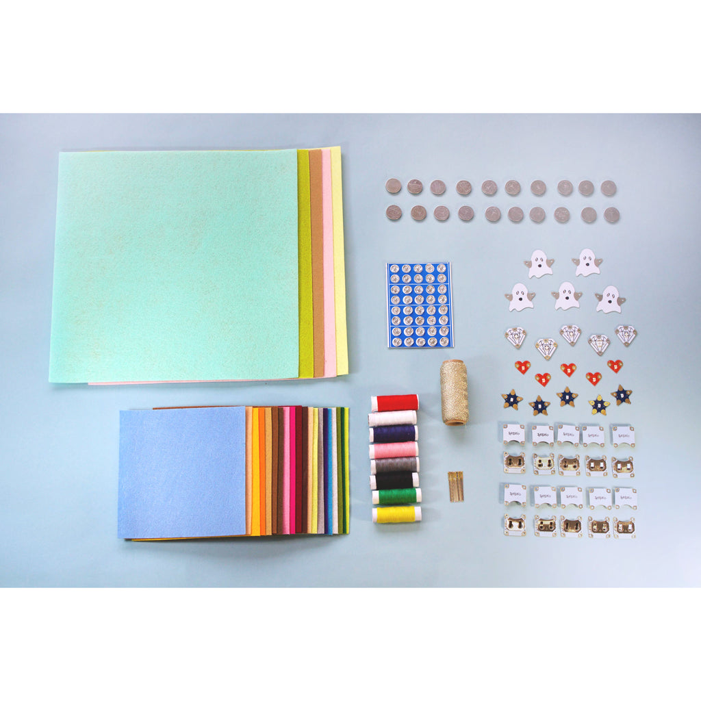 Contents of Teknikio Electronic Quilt Classroom Kit with felt swatches, batteries, conductive thread, LEDboards and other electronics components