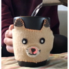 Photograph of sample project consisting of felt fox-shaped mug cozy with temperature sensor and red light in its nose