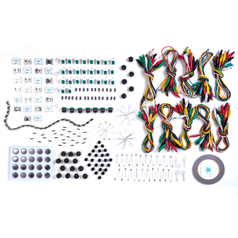 Teknikio Sparking Sense bundle contents, including alligator clips, sensors, LED boards, and batteries