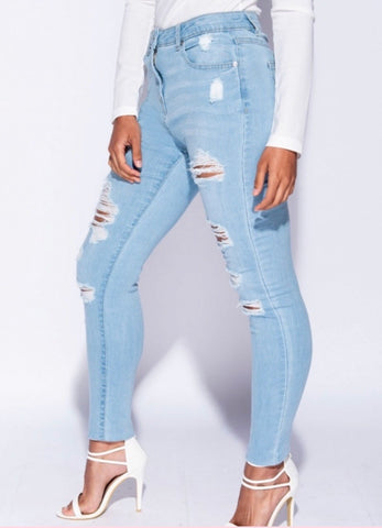 High waisted distressed jeans