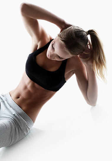 athletic woman doing side situps