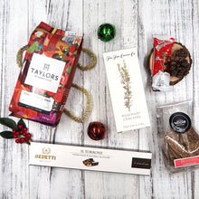 Start your Christmas morning right with The Christmas Morning Hamper. Have a cuppa of Christmas Blend coffee with some wholesome biscotti and crackers. Munch on some chocolate and nougurt before continuing the festive feasting in the afternoon.