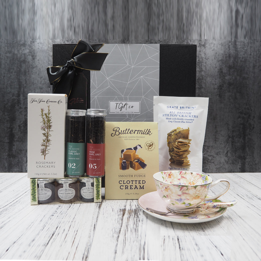 Afternoon tea with biscuits, crackers, fudge and jam. Comes with a pretty tea cup set. Free gift hamper delivery within Singapore