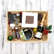 With a bottle of mini champagne, chocolate bites, sweets and honey, our Snazzy Christmas Hamper is the ideal gift for that stylish friend of yours!