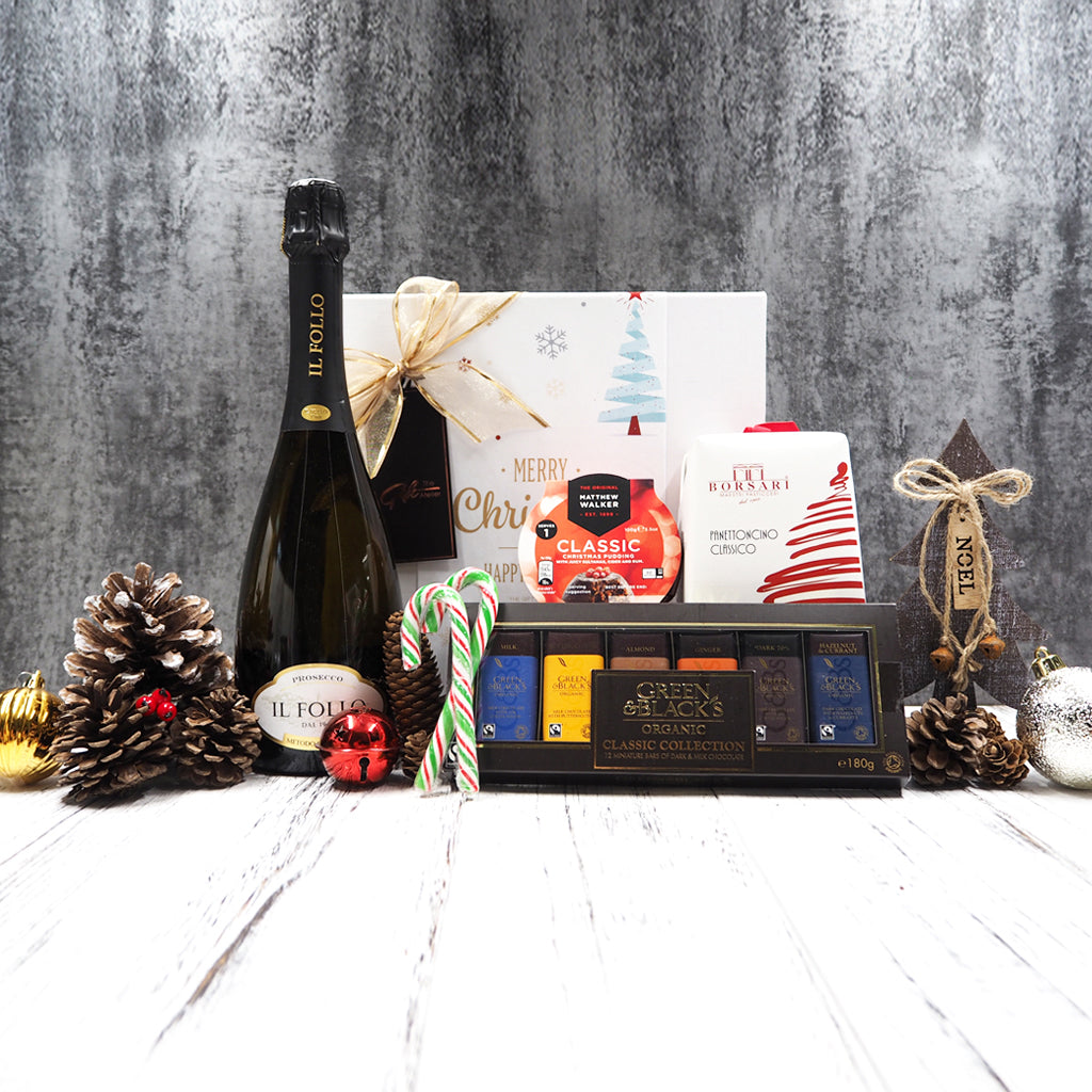 Our Sweeter Than Sweet Christmas Hamper is filled with sweet treats such as chocolate, christmas pudding, panettone and sweet wine, this is the perfect hamper for someone with a sweet tooth.