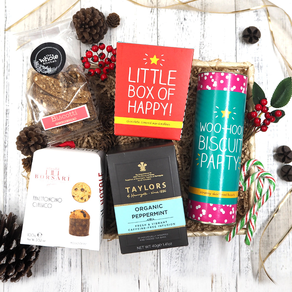 Our Jolly Christmas Hamper is packed to the brim with delicious festive goodies such as tea, bsicotti, panettone, chocolate mallows and shortbread.
